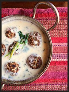 Lauki kuttu ke kofte in peanut coconut curry