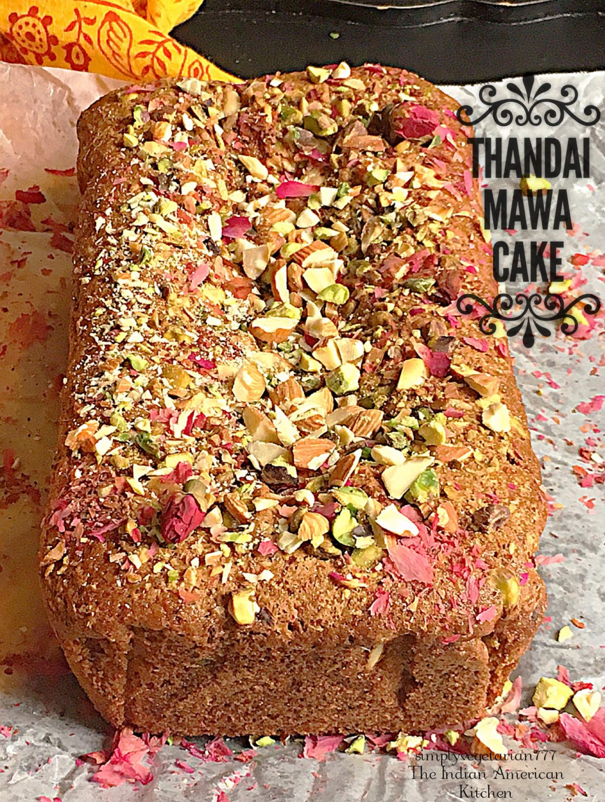 Thandai Mawa Cake is a rich and decadent cake made with Thandai flavors and Mawa (milk solids). It tastes like Indian Mithai and has super moist texture. This cake is perfect to celebrate any Indian Festival. #egglesscake #eggfreecake #thandairecipe #mawacake #fusioncakes #indiancake #mithaicake