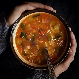 Tuscan Vegetable Soup Instant Pot Recipe is an easy + delicious + nutritious recipe. It is loaded with seasonal vegetables and cannellinibeans and mildly flavored with seasonings. The soup is light in calories but very filling. Add some shell pasta in it or put some bread on the side and make it a complete meal. #italiansoup #tuscansoup #souptoscana #vegetariansoup #vegansoup #glutenfreesoup #wintersoup #soup