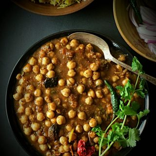 This Instant Pot Chana Masala Recipe is the lip-smackingly delicious recipe for infamous Delhi Style PUNJABI CHHOLE. Detailed recipe is given to cook these in Instant Pot or Traditional Pressure Cooker. A small video clip is also attached for better understanding. Read the complete post for many tips and tricks to cook Indian Restaurant Style Chickpeas Curry at home. It is best enjoyed with warm Naan or Rice. The best part is that it is completely VEGAN and GLUTENFREE. #vegancurry #instantpotvegancurry #instantpotchanamasala #instantpotrecipes #instantpotindianrecipes #instantpotchickpearecipes #instantpotchickpeacurry #instantpotglutenfrerecipes #dilliwalechhole #delhistylechhole #punjabichhole