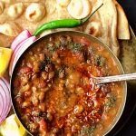 You are going to love this Punjabi Dhaba Daal Instant Pot Recipe. It is finger licking delish and every bite is worth devouring. Creamy and Decadent and what not. It tastes best with Tandoori Roti in my opinion. But goes very well with Rice and Naan too. Stove top instructions + small video included too. #instantpotrecipes #instantpotlentils #instantpotindianrecipes #instantpotdaal #instantpotbeans #dhaabadaal