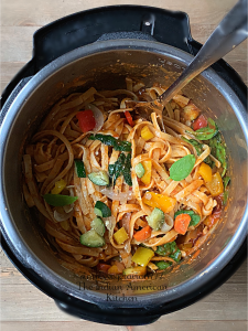Instant Pot Pasta Primavera made with Rainbow Carrots and other Seasonal Vegetables is a perfect recipe for the Holiday Season. Serve it for Thanksgiving or any Dinner night. It is simply delicious. #instantpotpasta #thanksgivingrecipe #pastaprimavera #fettucine #Vegetablepasta #holidaypasta