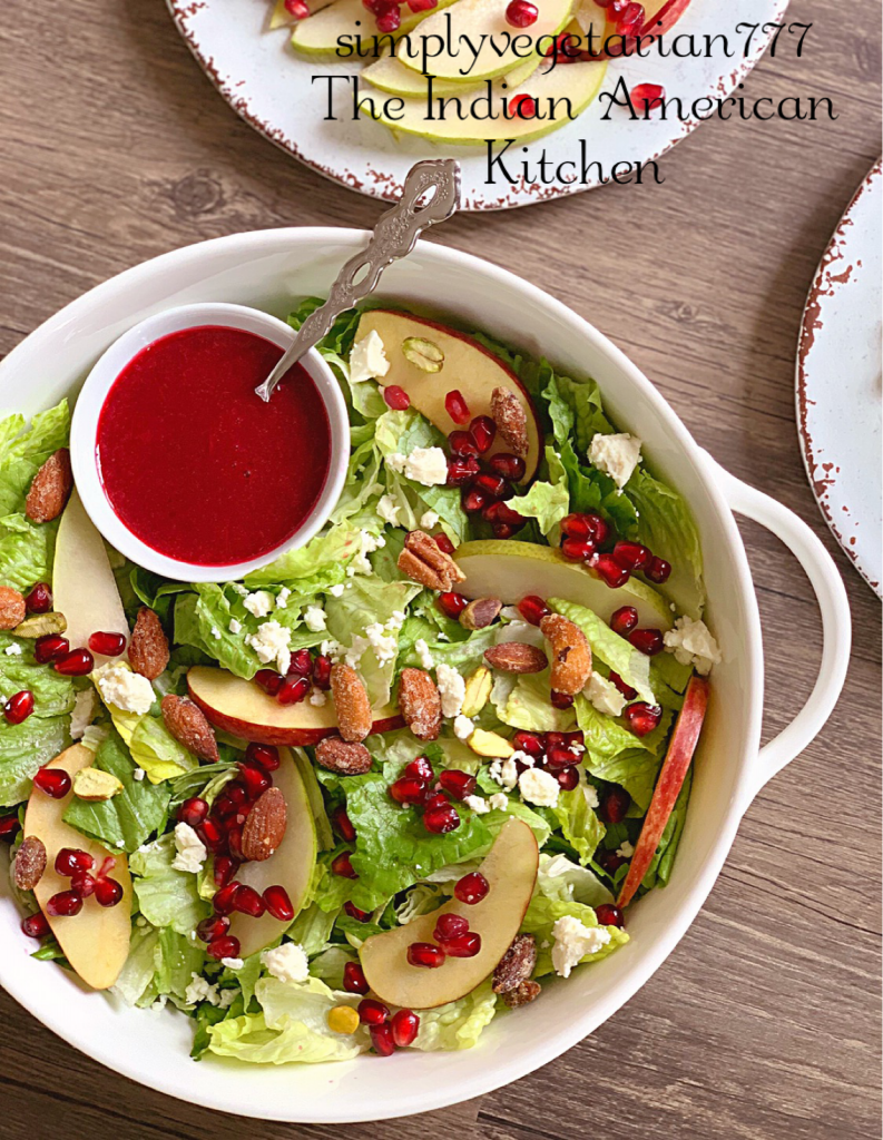This Holiday Salad is a perfect Salad to make for your Holiday Entertaining. It is colorful, well textured and super delicious. Homemade Cranberry Vinaigrette is cooked partially in Instant Pot and is finger-licking good. #holidaysalad #cranberryrecipes #vinaigretterecipe #holidayrecipes #easyholidayside #instantpotholidayrecipe