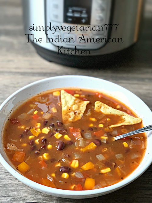 Vegetarian Enchilada Soup is just perfect for this cold weather. The best part is that it is made in Instant Pot. And it is a dump and go kind of recipe. Just 5 minutes of Cookig time in Instant Pot and a hearty filling dinner is ready in no time. #vegetariansoup #enchiladasoup #vegetarianenchiladasoup #instantpotenchiladasoup #instantpotsoup #easymeals #vegetariandinner